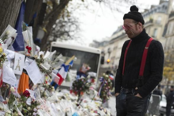 Singer of the US rock group Eagles of Death metal Jesse Hughes pays tribute to the victims of the November 13 Paris terrorist attacks at a makeshift memorial in front of the Bataclan concert hall on December 8, 2015 in Paris. The Eagles of Death Metal band returned to the Bataclan concert hall in Paris, nearly a month after they survived a jihadist attack there in which 90 people died.